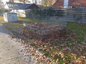 De bak met bladeren